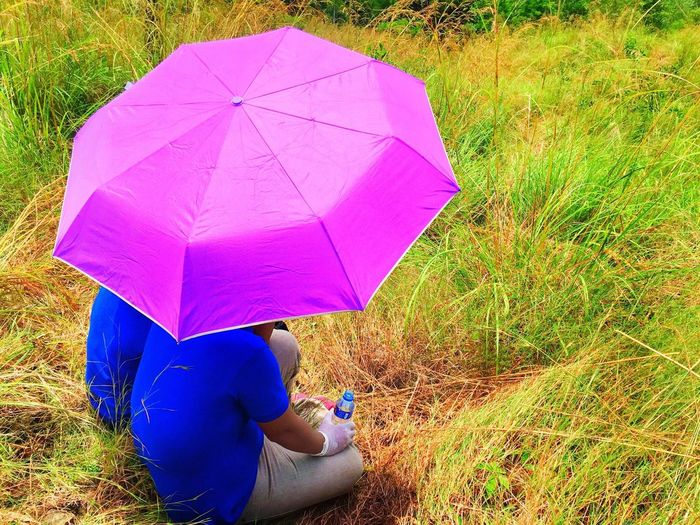 Cabangan, Zambales, Philippines Grass Umbrella Field Holding Relaxation Grassy Meadow Day Vibrant Color Outdoors Casual Clothing Tourism Tranquility Solitude Pink Color Person Practicing Green Color Non-urban Scene Break The Mold