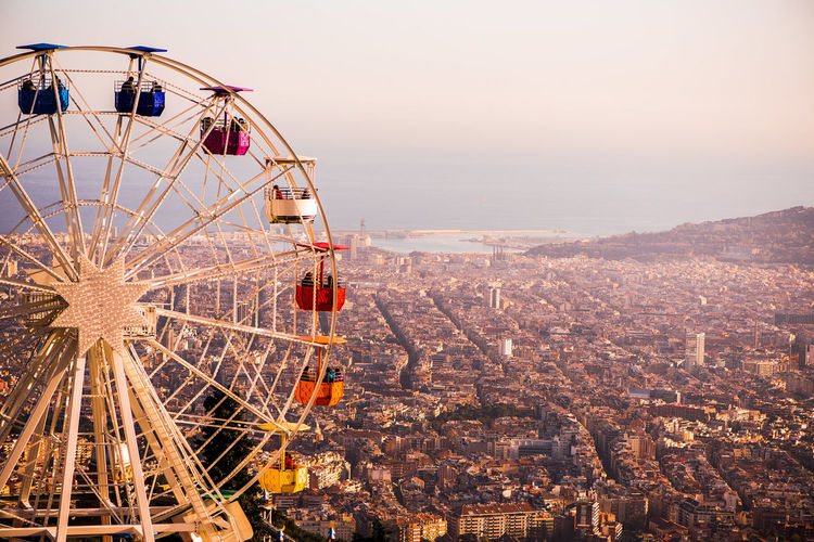 Ferris Wheel Against Barcelona Cityscape