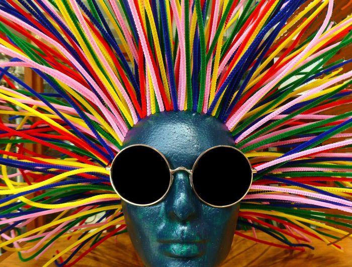 SUNGLASSES Blue Face Blue Head Sunglass Frames Close-up Looking At Camera Multi Colored Store Display Sunglasses
