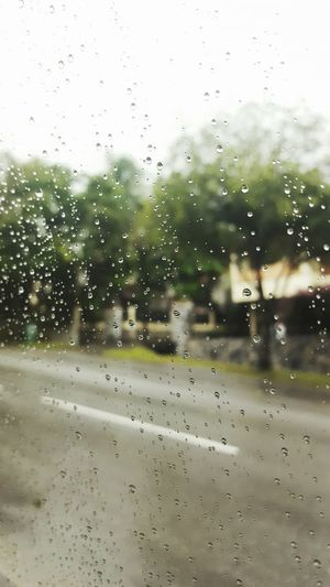 View of wet window in rainy season