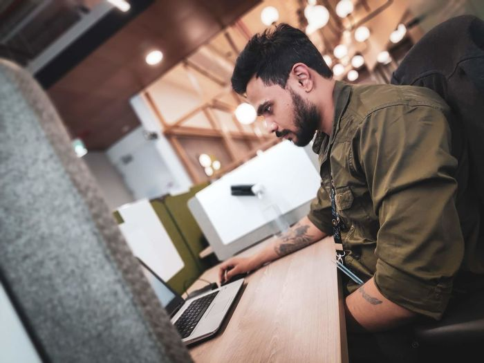 Side view of man working at office