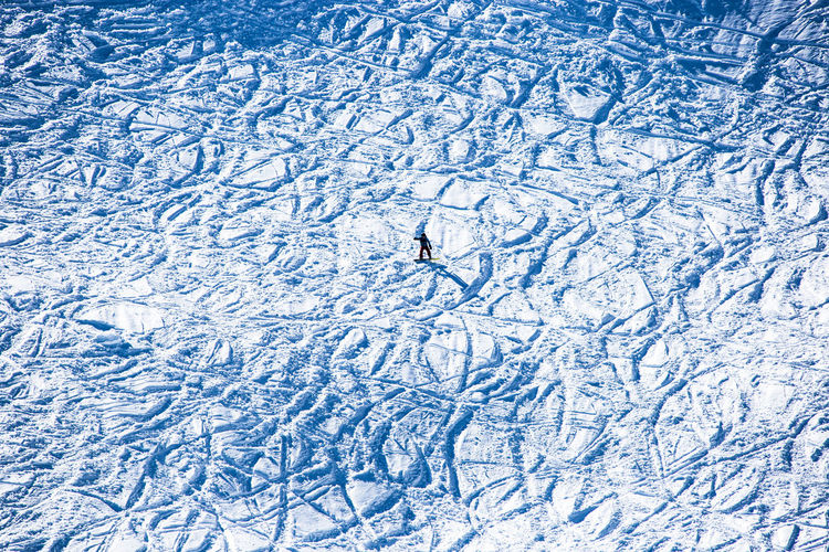 Outdoor fun Winter Snow Nature Cold Temperature Blue High Angle View Day Sport Full Frame Winter Sport Lifestyles Motion Ice Unrecognizable Person Beauty In Nature Outdoors Backgrounds Leisure Activity Suny Day Swimming Mountain Austria Alps Skiing