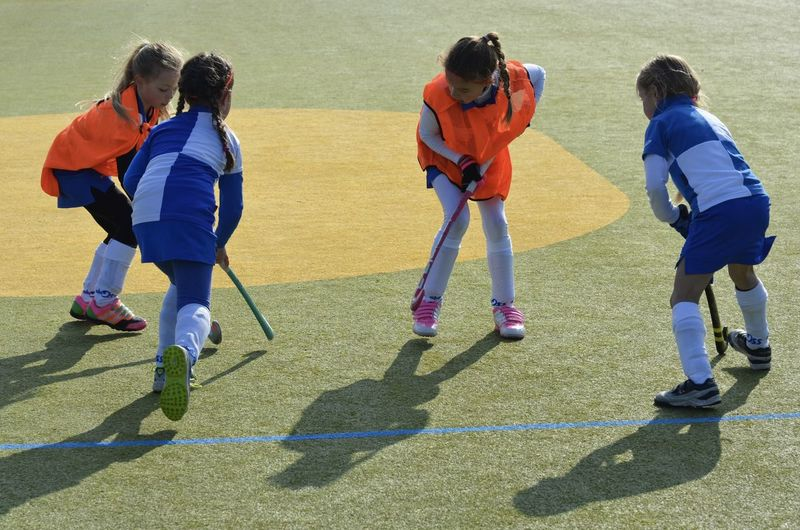 Hockey game Bonding Childhood Elementary Age Girls Hockey Game Innocence Play Real People Sporting Girls In Action Togetherness