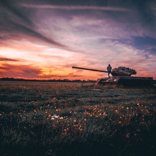 Sit on an tank and enjoy the sunset.