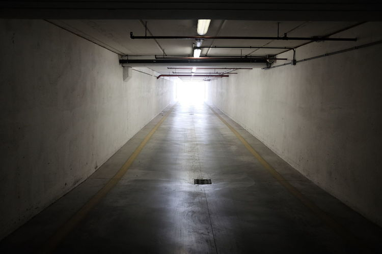 covered parking exit tunnel Dark Entrance Modern Underground Architecture Built Structure Concrete Corridor Empty Exit Garage Illuminated No People Parking Passage Perpective Tunnel