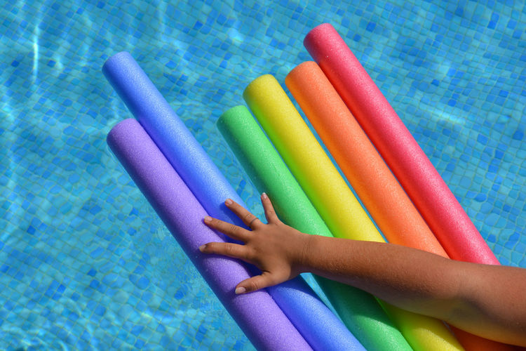 High angle view of colored pencils in swimming pool