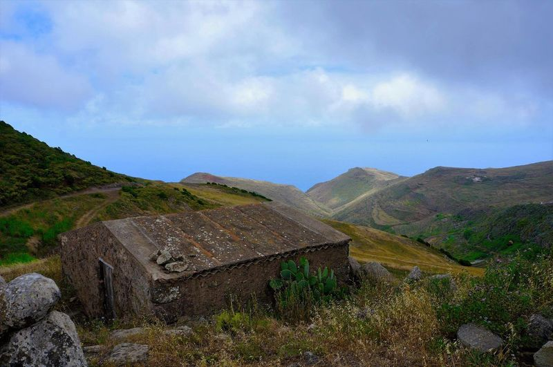 Mountain History Landscape Cloud - Sky Sky Nature Mountain Range Travel Destinations No People War Outdoors Scenics Architecture Ancient Civilization Winding Road Beauty In Nature Day Tenerife Water Old Farm House