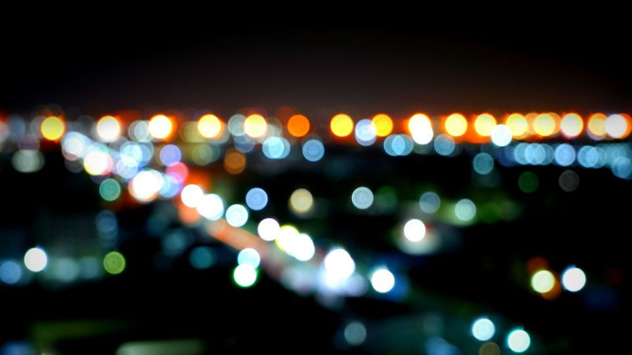 Abstract blurred colorful bokeh of night lights city with highway in landscape view for background decorations concept Glitter High Angle View Bright Blurred Row Night Lights City Multicolored Colorful Highway Circle Horizontal Outdoors Shiny Electricity  Bokeh Landscape City Defocused Illuminated Black Background Multi Colored Electricity  Street Light Electric Light Glowing Countryside Shining Geometric Shape Abstract Backgrounds