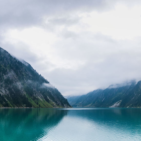 Schlegeis Reservoir Adventure Alps Beauty In Nature Blue Calm Cloud Lake Landscape Mountain Mountain Range Nature No People Non-urban Scene Outdoors Reflection Sky Tourism Tranquil Scene Tranquility Travel Traveling Vacations Water Wilderness Zillertal