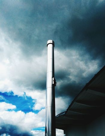 The Architect - 2017 EyeEm Awards Low Angle View Cloud - Sky Industry Smoke Stack Factory No People Day Outdoors Nature Steel Chimney Chimney Roof Storm Cloud Stormy Weather Storm