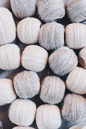 Textile Still Life No People Close-up Backgrounds Full Frame Large Group Of Objects Arrangement Abundance Wool Choice Variation Pattern Textured  Softness Ball Of Wool In A Row Neutral Colors Yarn Yarn Balls Cotton Cotton Balls Strings