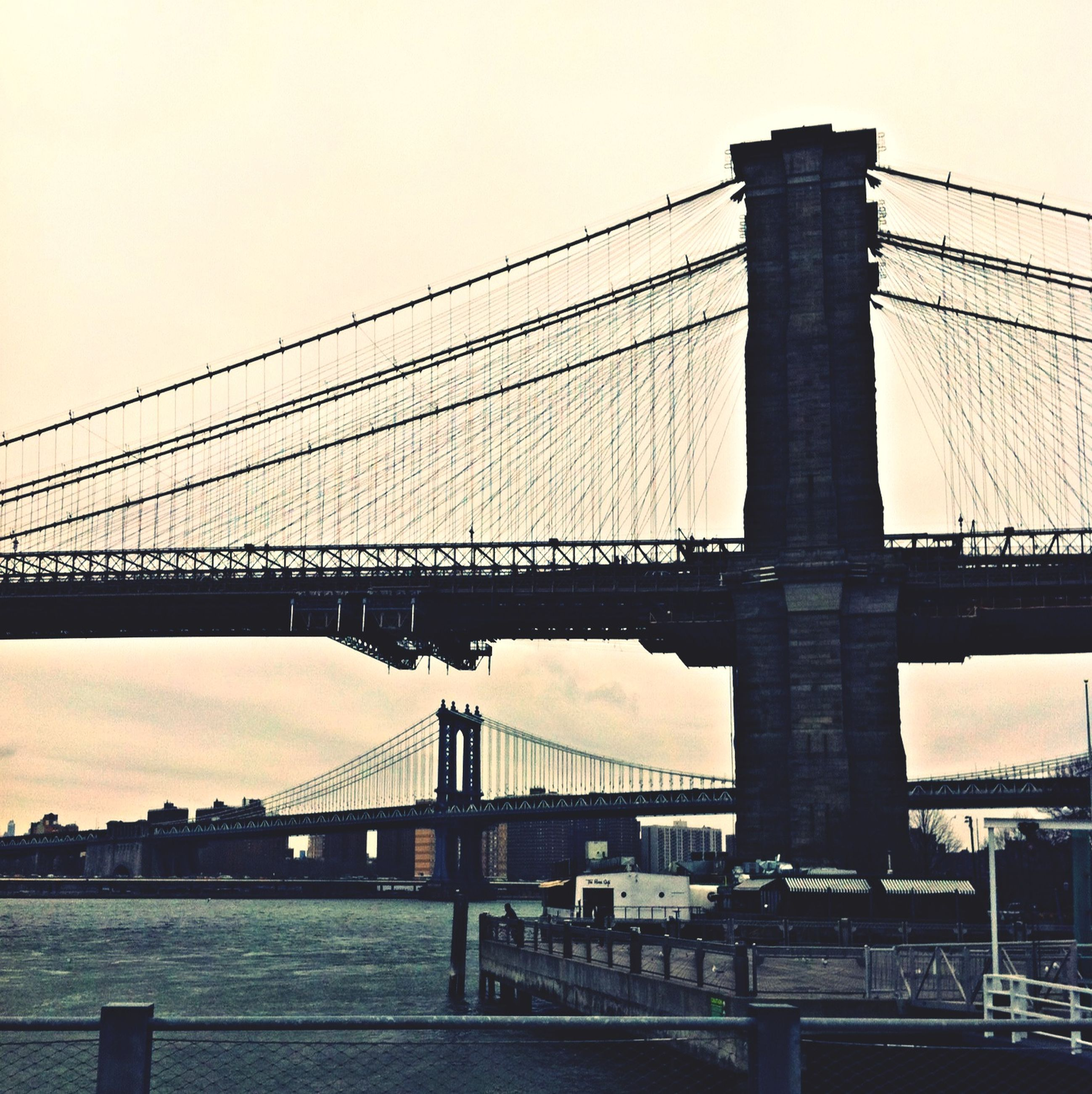 connection, bridge - man made structure, built structure, architecture, engineering, suspension bridge, bridge, transportation, clear sky, low angle view, cable-stayed bridge, cable, sky, city, travel destinations, river, long, brooklyn bridge, outdoors, no people