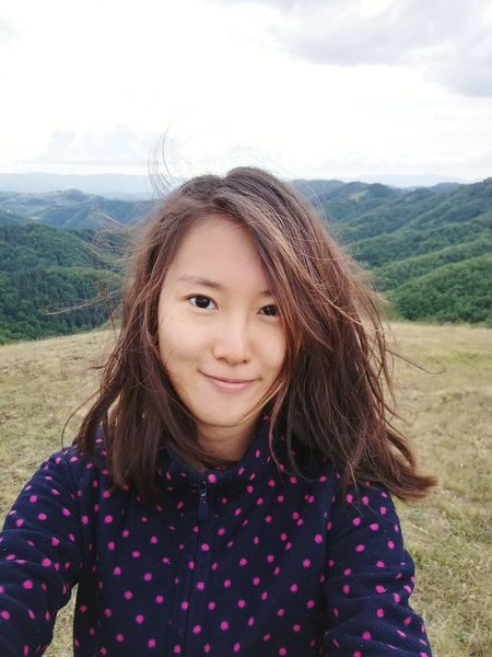 EyeEm Selects Looking At Camera One Girl Only Smiling Mountain Day Selfıe Portrait Cloud - Sky Nature Outdoors Sky Happiness Cheerful Asian  Freshness Mother Nature Windy Casual Clothing Nature Real People One Person Tree Goodday Green Colour