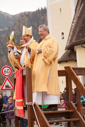 Schliersee, Bavaria - November 5, 2017: Every year on the 1st Sunday in November, the Idyllic Horse procession, named Leonhardi in Bavarian Schliersee takes place in commemoration of Patron St. Leonhard. In traditional clothing and decorated horse-drawn carriages horses and riders move to the church of St. Leonhard Bavaria Bishop Leonhardi Leonhardi Ride Patron St. Leonhard Rider Schliersee Traditonal Clothing Architecture Building Exterior Built Structure Cart Day Decorated Horse Horse Carts Horse Procession Idyllic Men Mesner Outdoors Pastor People Real People Togetherness