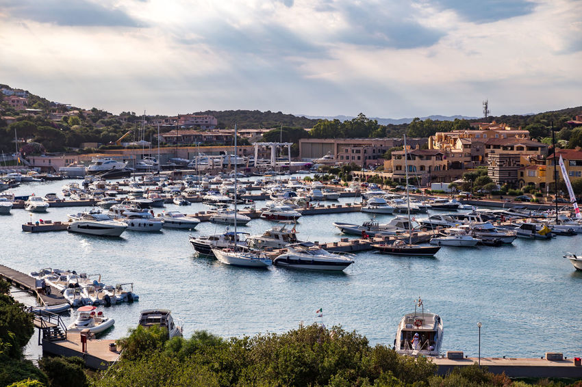 A view over the Porto Cervo marina as seen from Stella Maris Church Harbor Harbour Harbour View High Society Jet Set Marina Porto Cervo, Sardinia Architecture Day Italy Nature No People Porto Cervo Sardegna Sardinia Sea Sky Sun And Clouds Water Yacht