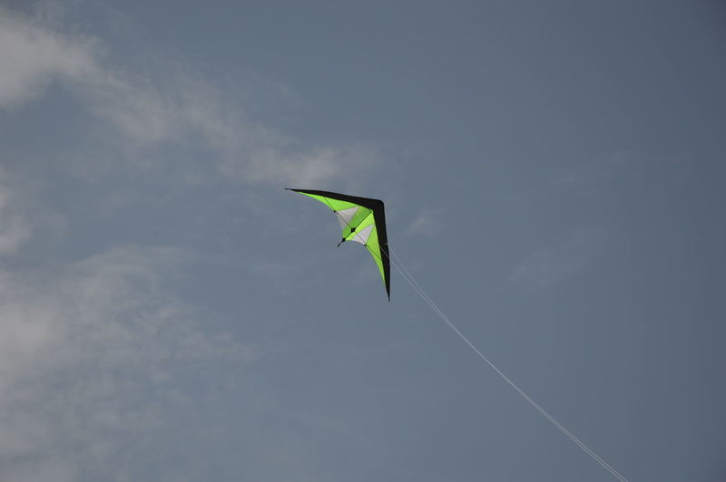 A steering kite in the blue sky A Steering Kite In The Blue Sky Copy Space Twine Copy Space Copy Space In Sky Cords Cords And Wires Flying Kite - Toy Kite Flying Kite, Flying No People Outdoors Pastime Sky Sport Steering Kite Twine, Cord, Yarn, Thread, Strand, String