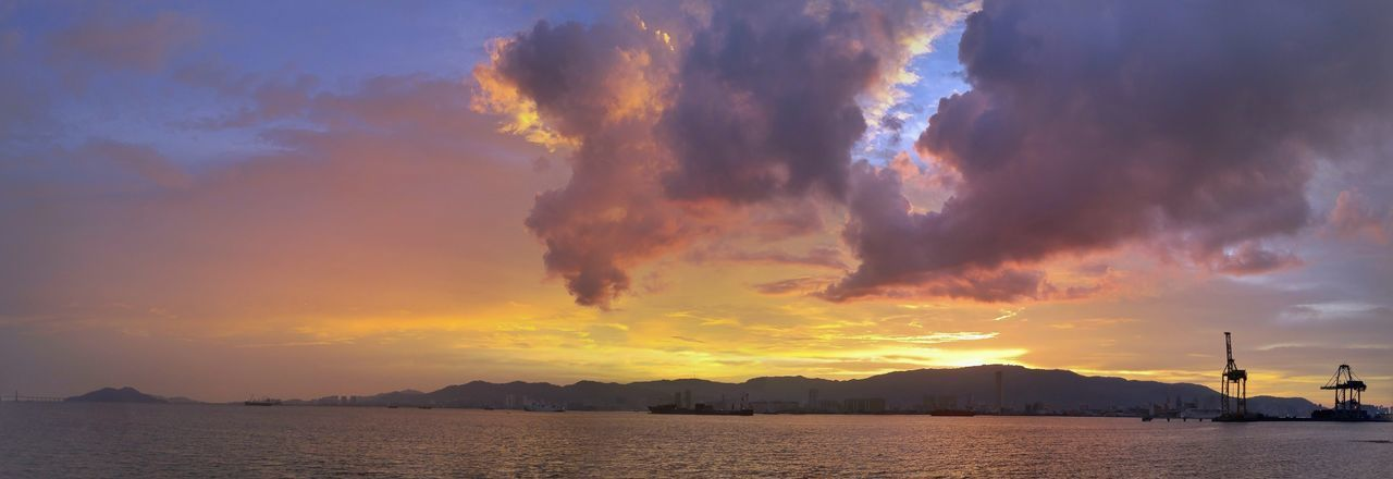 Panorama of a sunset sea view behind an island mountain Cloud Sky Mesmerizing Island Mountain Port Panorama Penang Georgetown Malaysia Colourful Landscape Oil Pump Water Sunset Nautical Vessel Mountain Sea Silhouette Social Issues Dramatic Sky Awe Bay Of Water Suspension Bridge Seascape Low Tide Coast Tide Lagoon Power In Nature
