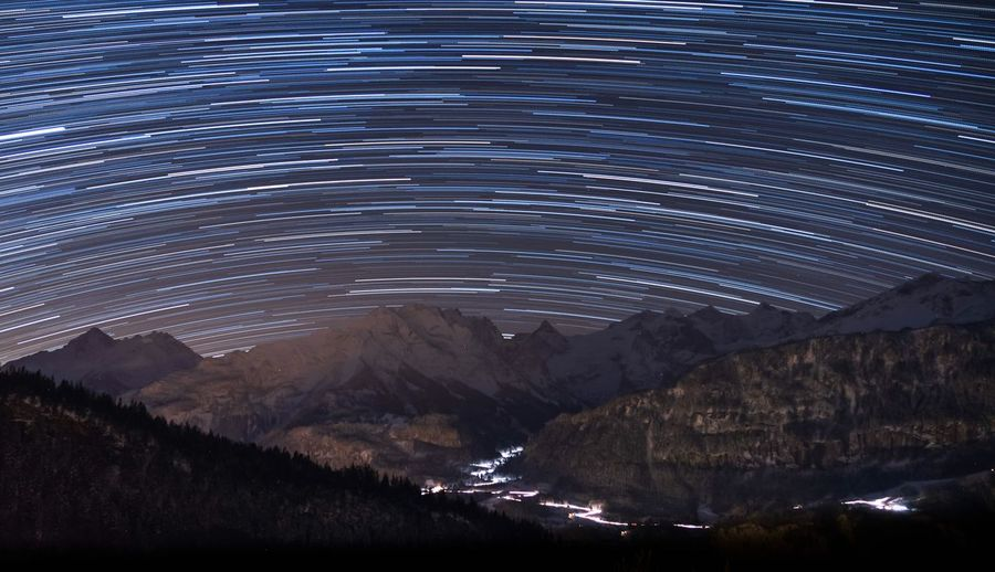 Night Mountain Beauty In Nature Scenics - Nature Nature No People Capture Tomorrow Star - Space Illuminated Environment Sky Outdoors Land Tranquil Scene Astronomy Space Motion Landscape