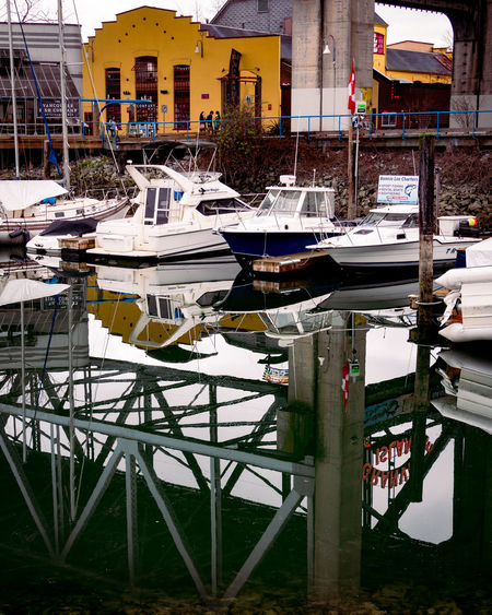 Architecture Building Exterior Built Structure Water Nautical Vessel Transportation Moored Building Mode Of Transportation Harbor City No People Reflection Day Nature Outdoors Residential District Waterfront Lake Sailboat Marina Yacht