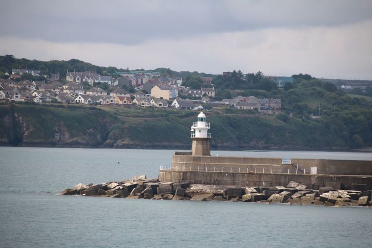Fishguard Wales Architecture Breakwater Building Building Exterior Built Structure Day Direction Guidance Lighthouse Mountain Nature No People Outdoors Protection Rock Sea Security Sky Tower Water Waterfront