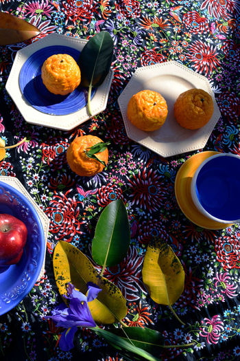 Still life with oranges, ethnic dishes on the background of Spanish tablecloth Africa Andalusia Colorful Ethnic Flat Lay Flower Food Fruits Leaves Marocco My Favorite Photo Naturel Life Park No People Pattern Still Life Tablecloth