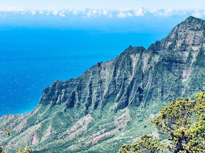 Hawaii Kauai Na Pali Coast Sky Beauty In Nature Nature Scenics - Nature No People Day The Traveler - 2018 EyeEm Awards Mountain Plant Water Sea Tranquility Tranquil Scene Land Cloud - Sky Outdoors Growth Tree Mountain Range Blue Mountain Peak