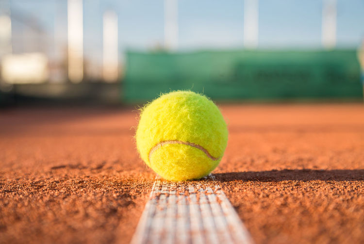 Close-up of tennis ball on field