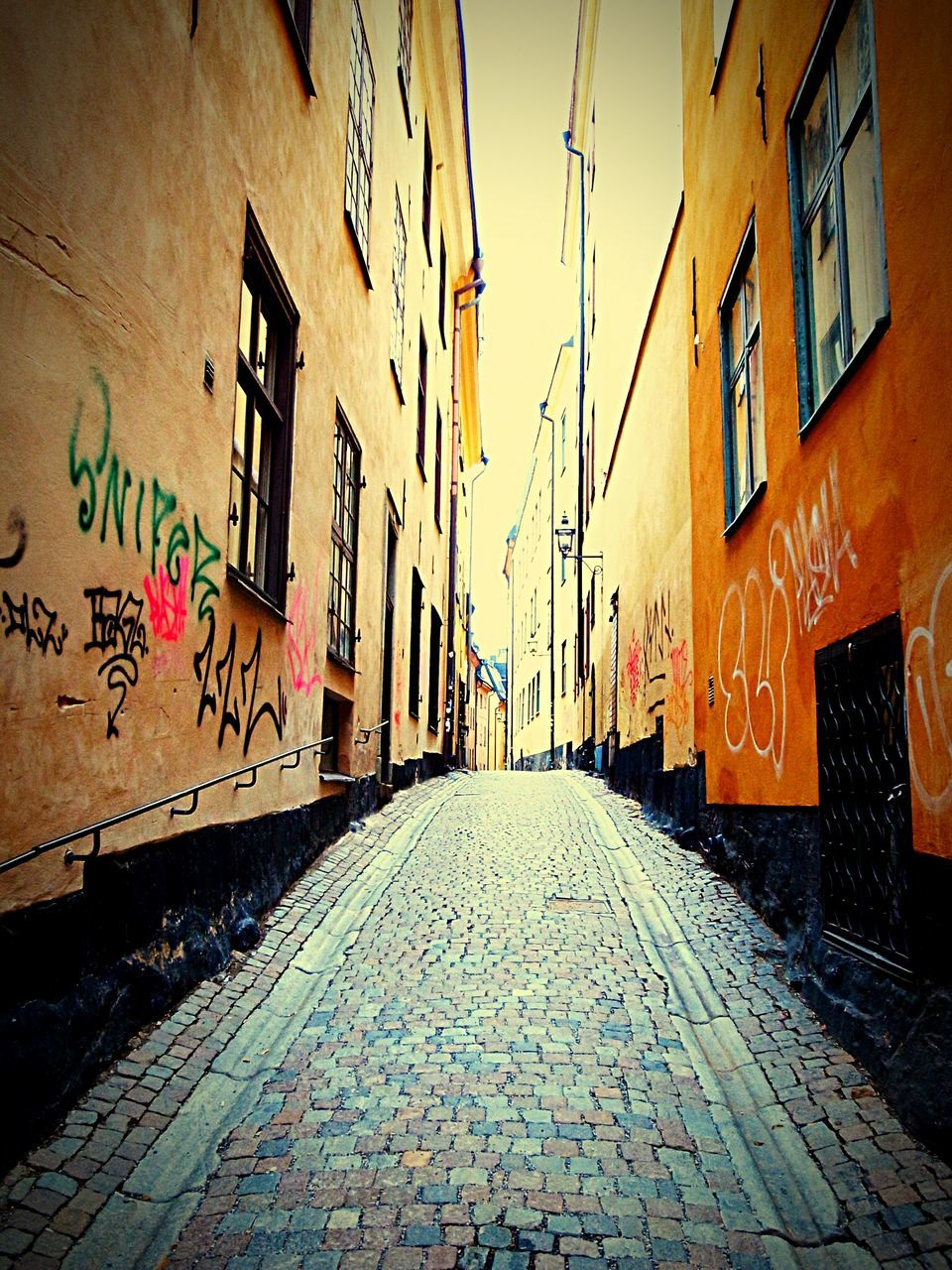 cobblestone, architecture, building exterior, built structure, street, city, the way forward, alley, outdoors, day, no people, sky
