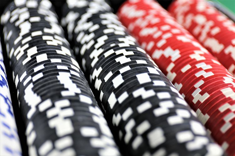 An concept Image of some poker Chips in a Casino Casino Gambling Las Vegas Luck Lucky Poker RISK Vegas  Win Bet Card Cards Chance Chip Chips Concept Gamble Game Loose Money Poker - Card Game