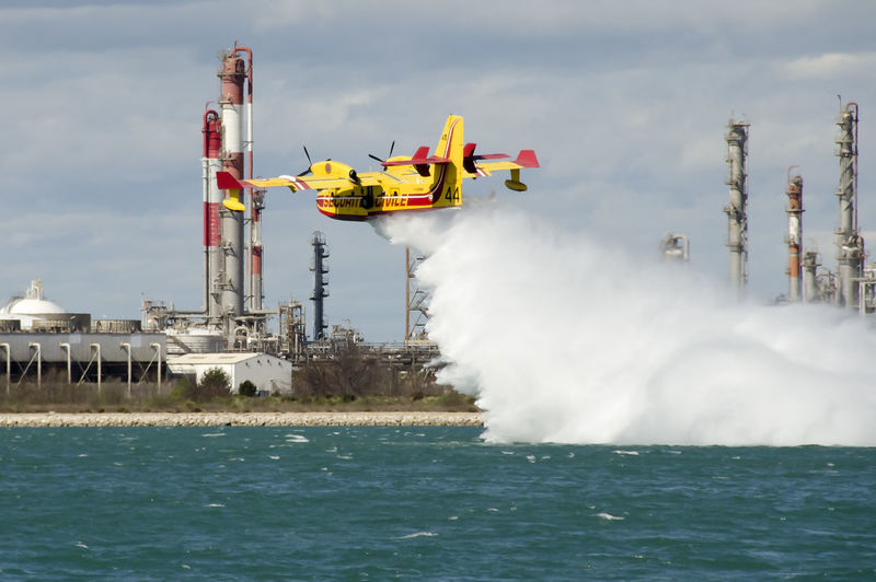 Canadair, water bomber plane in training in the harbor Firefighter Harbor Plane Air Vehicle Aircraft Airplane Architecture Cloud - Sky Day Flying Industry Mode Of Transportation Motion Outdoors Pollution Sea Sky Transportation Water Water Bomber Waterfront