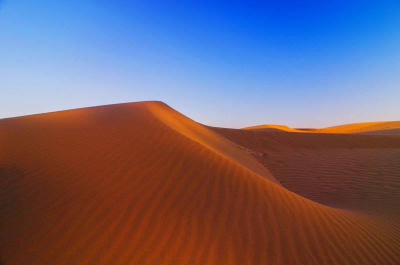 Oetune beach. id. scenic view of desert against clear blue sky