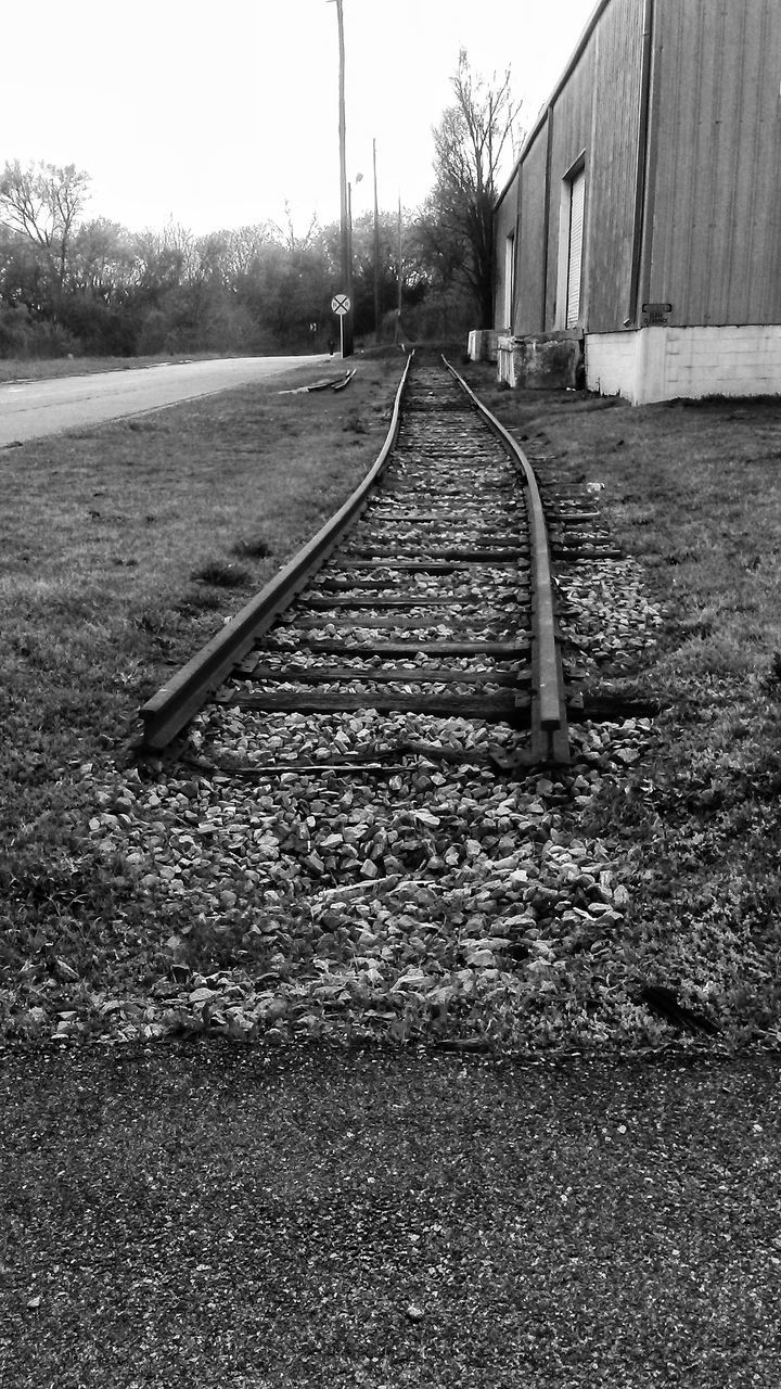 day, transportation, no people, railroad track, tree, outdoors, the way forward, built structure, architecture, building exterior, nature, sky