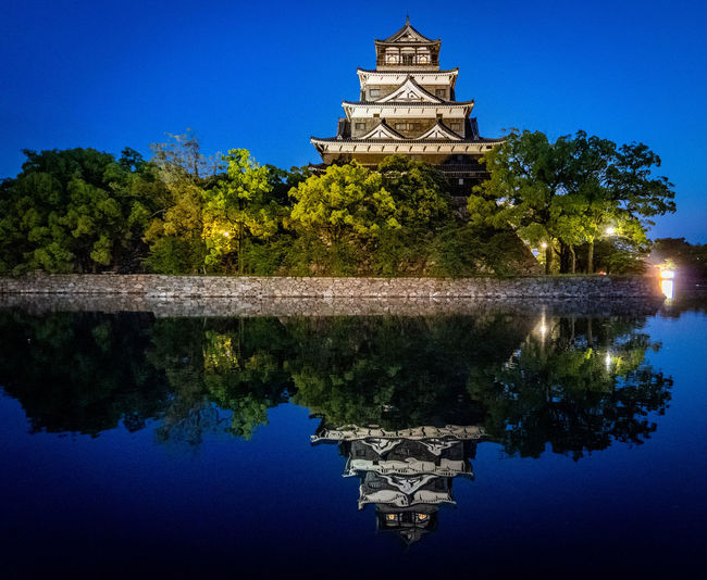 Water Built Structure Architecture Reflection Building Exterior Nature Tree Plant No People Blue Belief Sky Religion Lake Waterfront History Travel Destinations The Past Building Outdoors Ancient Civilization