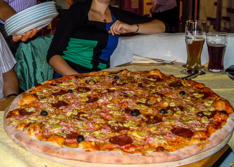 Riesen-Pizza (6 Personen) - Family pizza Stimmungsbild Hofi Riesenpizza Eating Exquisite Food Food Food And Drink Freshness Indoors  Italian Food Köstlich Lifestyles Pizza Plate Ready-to-eat Real People Table Women EyeEmNewHere Best Shots Hofi Crafted Beauty Food Stories