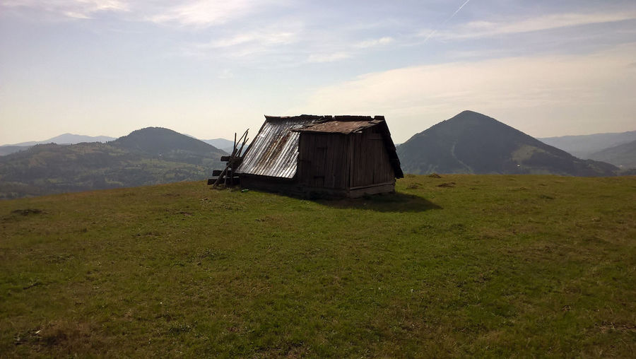 The Carpathian Mountains Charpathian Nature Architecture Backgrounds Beauty In Nature Building Exterior Built Structure Day Field Grass Landscape Mountain Mountain Range Nature No People Outdoors Scenery Scenics Sky Tranquility