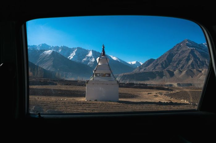 Stupa through window Winterinladakh Stupa Ladakhi Architecture Window View Perpective View From The Window... Framed Frame In Frame Leh Ladakh.. Buddhist Stupas Buddhist Art Chorten Environment Eyem Best Shots EyeEm Best Shots - Nature Eyem Best Shot - Architecture Eyem Best Shot Eyem Best Edits EyeEm Best Shots - Nature Mountain Mountain Range Snow Landscape Travel Destinations No People Architecture Nature Outdoors Day Sky EyeEmNewHere Shades Of Winter