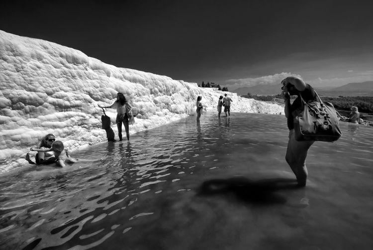 People enjoying in travertine pool at pamukkale
