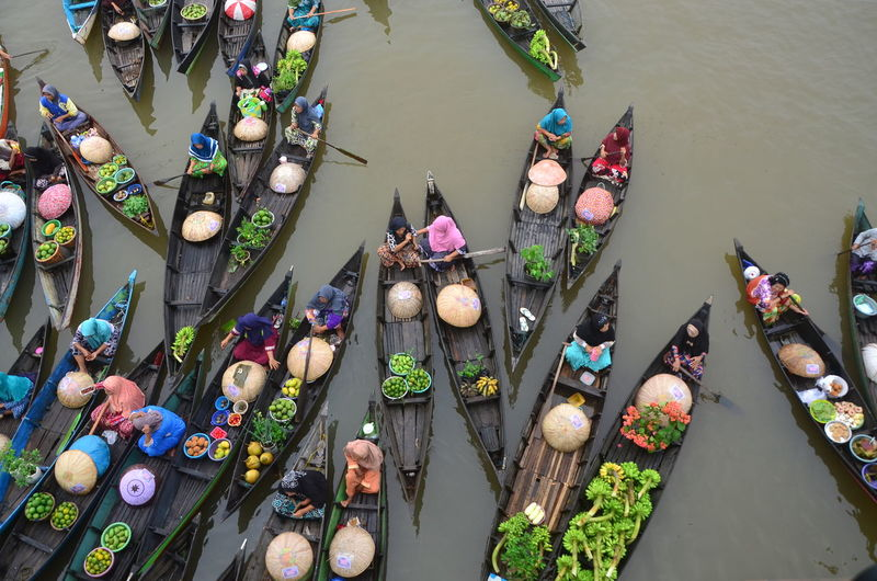 High angle view of multi colored boats in lake