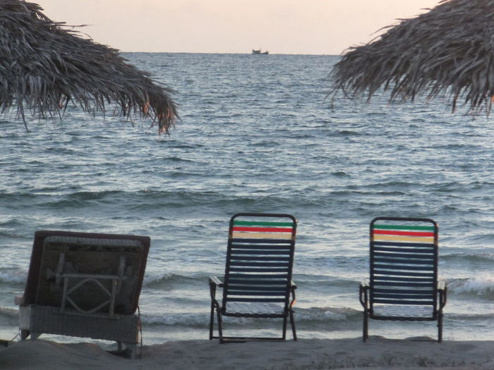 Beach Beauty In Nature Chair Coastline Horizon Over Water Idyllic Nature Relaxation Sand Scenics Sea Shore Sky Tranquil Scene Tranquility Vacations Water