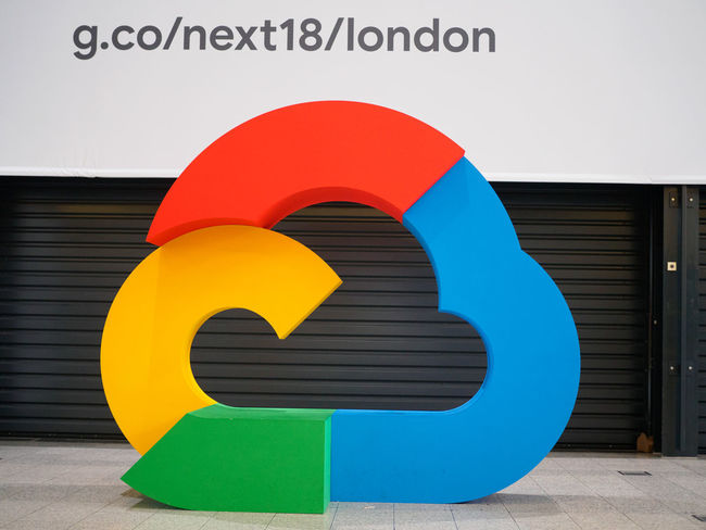 Google Cloud Platform logo at Google Cloud Next London '18 Logo Built Structure Communication Creativity Design Google Cloud Next London '18 Google Cloud Platform Multi Colored Red Shape Sign Symbol Text Western Script Yellow
