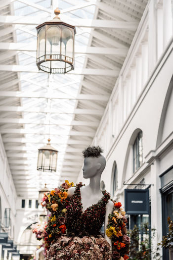 Fleurs de Villes Floral Couture Installation in Covent Garden Market Building. Architecture Built Structure Day Luxury Couture Fashion Blossom Springtime London Uk England Covent Garden  Covent Garden Market Floral Fleurs Landmark Extravaganza Shopping Artist Flower Building Exterior No People Low Angle View Art And Craft Building Human Representation Sculpture Lighting Equipment Plant Representation Flowering Plant Nature Creativity Outdoors Window Focus On Foreground Ceiling Flower Arrangement