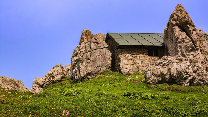 trail to kampenwand Aschau Kampenwand Architecture Blue Building Building Exterior Built Structure Clear Sky Copy Space Day Environment Grass House Land Landscape Nature No People Outdoors Plant Rock Rock - Object Sky Solid