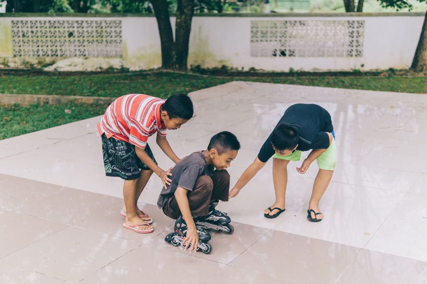 Child Boys Males  Childhood Family Care Togetherness People Playing Outdoors Day Happiness Full Length EyeEmNewHere Street Photography Fun Cheerful Friendship The Street Photographer - 2017 EyeEm Awards The Great Outdoors - 2017 EyeEm Awards