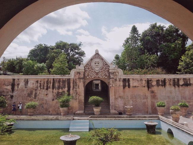 One of tourism site in Yogyakarta Ancient Ancient Architecture Arch Architecture Building Exterior Built Structure Day Entrance Fountain Miles Away Outdoors Plant Sky Taman Sari - Yogyakarta Tourism Travel Destinations Tree Water