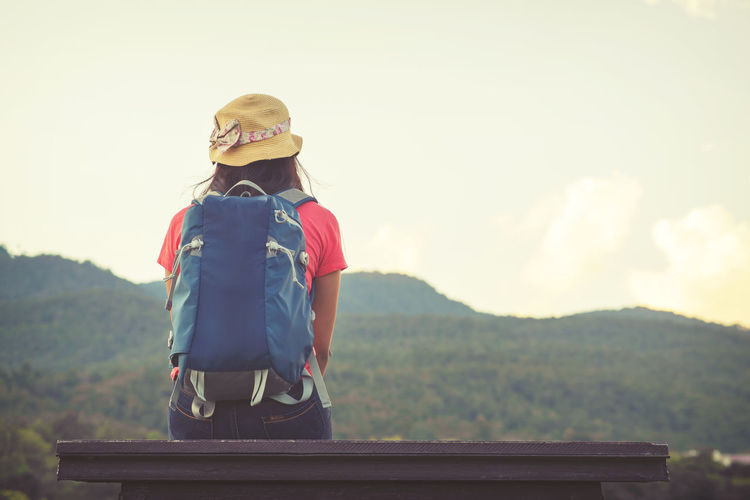Traveler Asian woman with backpacks and sit looking landscape of the mountainous. vintage color effect Adventures Holiday Travel Traveling Vintage Style Woman Adventure Backpacker Day Elementary Age Girls Journey Mountain Mountains Nature One Person Outdoor Outdoors People Real People Sky Standing