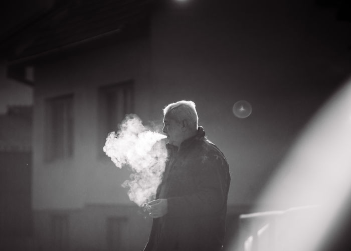 Reflection of man smoking cigarette