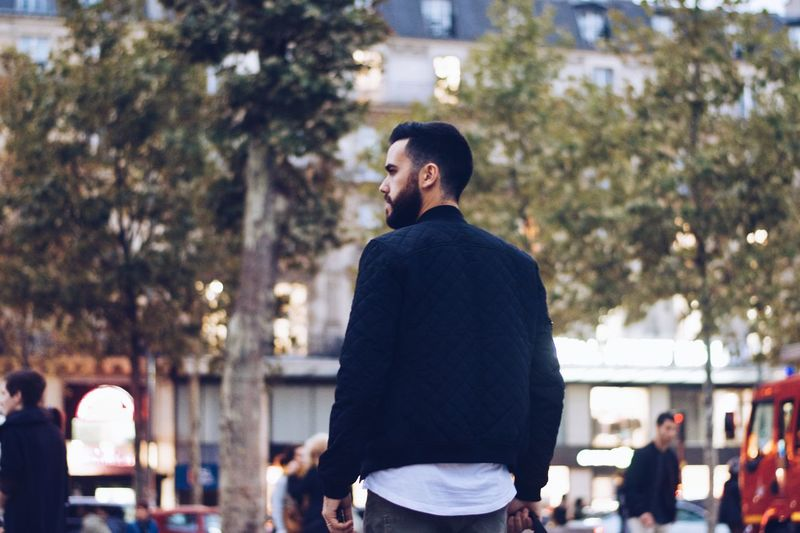 The Parisian Scene III Black Paris Man Real People One Person Lifestyles Leisure Activity Tree Standing #urbanana: The Urban Playground Focus On Foreground Men Incidental People Clothing Rear View Day Casual Clothing Waist Up Outdoors