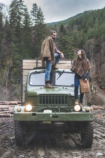 Women Woman Clothes Dresses Forest Timber Men Boy Jeans Transportation Truck Vintage Vintage Car Fashion Mode Of Transportation Tree Real People Land Vehicle Nature Motor Vehicle Casual Clothing Day People Full Length Adult Travel Plant Car Standing Leisure Activity Land Outdoors Mature Men