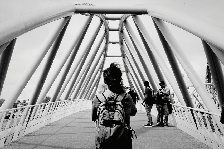 Bridge - Man Made Structure Connection Adult People Day Outdoors Women Young Adult Adults Only Young Women Only Women Sky Blackandwhite Peace Nemo Museum Renzo Piano Bridge The Week On EyeEm Your Ticket To Europe Amsterdam Holiday Friends Traveling Fun Urban Landscape