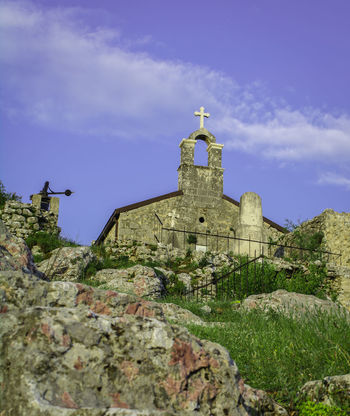 Church on hill Architecture Blue Church Cloud - Sky Cross Day Grass Hill History Low Angle View Nature Old Outdoors Religion Rock Sky Spirituality Travel Destinations